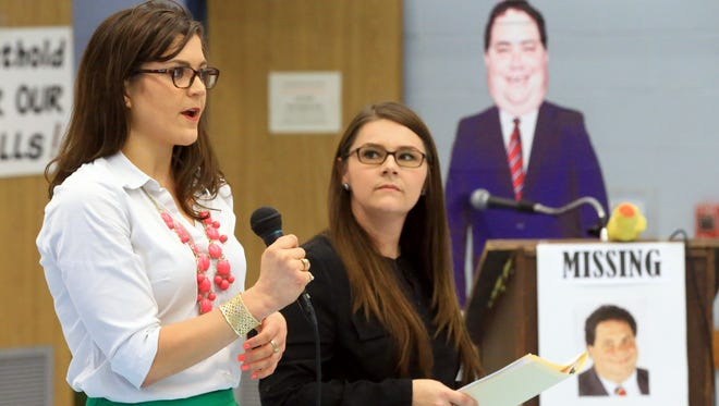 Lander Baiamonte (left) and Amber Lewis talks about contacting U.S. Rep. Blake Farenthold to host a town meeting Wednesday, April 19, 2017, at the Oveal Williams Senior Center in Corpus Christi. Farenthold was not in attendance because of obligations at another event, a representative with his office said.