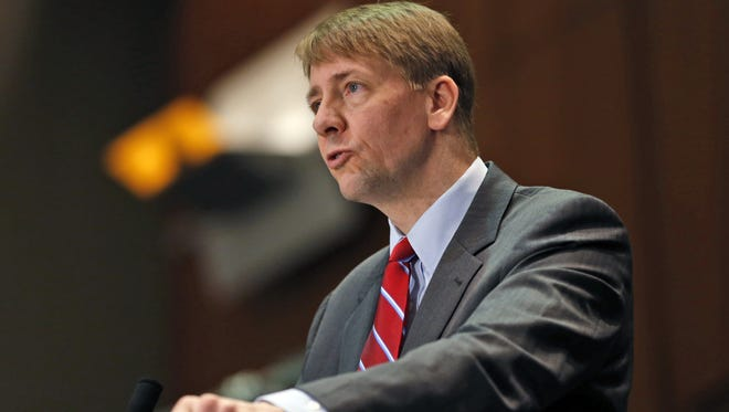 In this March 26, 2015, file photo, Consumer Financial Protection Bureau Director Richard Cordray speaks during a panel discussion in Richmond, Va. The bureau in July released  a proposed massive overhaul of the multibillion-dollar debt-collection industry. The changes would restrict collectors from calling numerous times a day, require them to more substantially prove a debt is valid, and give people more ability to dispute their bills. The CFPB is also proposing a 30-day waiting period on collection attempts for loans tied to a person who has recently died.
