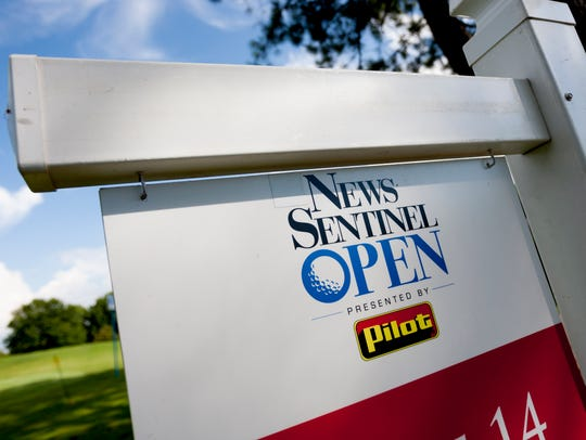 A sign depicting the News Sentinel Open logo at Fox
