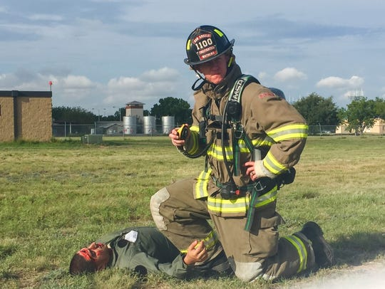Firefighter Shane Mathews assists volunteer 'victim'