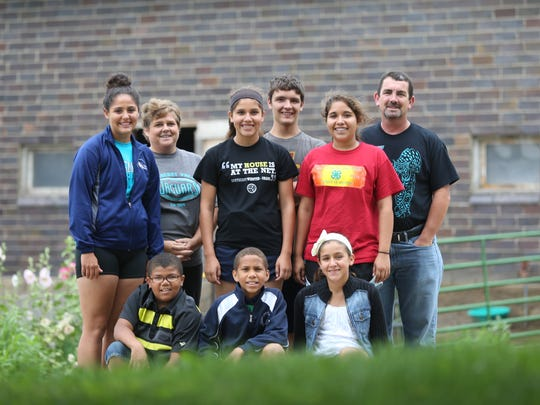 Members of the Scott family are, front row from left, Nate, Kaleb and Viatris, and, back row from left, Aaliyah, mom Lorna, Ebony, Bryce, Vanessa and dad Rob. They're shown outside their home near Pilot Mound on Aug. 15.
