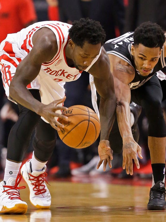 Houston Rockets guard Patrick Beverley, left, and San Antonio Spurs guard Dejounte Murray chase the ball during the first half in Game 3 of an NBA basketball second-round playoff series, Friday, May 5, 2017, in Houston. (AP Photo/Eric Christian Smith)