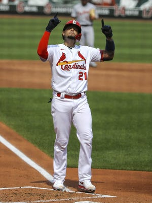 St. Louis Cardinals' Yadier Molina gestures skyward after hitting a two-run home run during the second inning in the first game of a baseball doubleheader against the Detroit Tigers Thursday, Sept. 10, 2020, in St. Louis. Molina is wearing the number 21 in honor of Roberto Clemente.