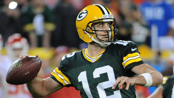 Green Bay Packers quarterback Aaron Rodgers (12) throws.