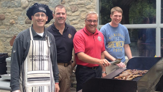 Brown County employees enjoyed a picnic at Pamperin Park in July with their annual event. Families, retirees and employees enjoyed games, food and conversation. Cooking for the occasion were, from left to right, County Executive Troy Streckenbach, Capt. David Konrath of the Sheriff's Department, Sheriff John Gossage and Bradley Gajeski of the Child Support Agency.