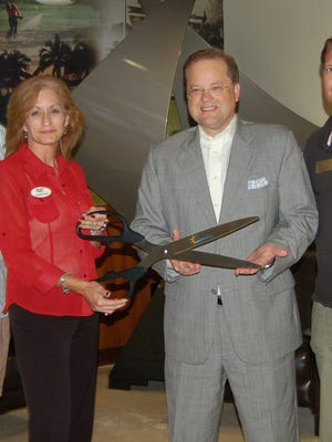 David Verano, Ana Maria Senica, John Cox and Stefan Muehlbauer with  scissors for Naples Chamber of Commerce.