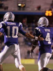 MTSU quarterback Logan Kilgore celebrates a TD pass with wide receiver Malcolm Beyah in 2011.