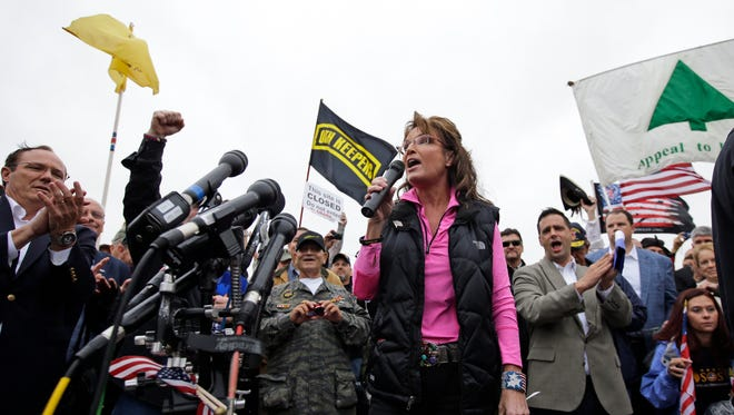 Sarah Palin demonstrates at the World War II Memorial to protest the partial government shutdown.