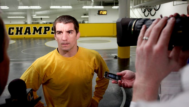 Former Iowa wrestler Brent Metcalf, seen here in 2012, takes on Aaron Pico Friday.