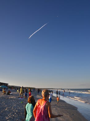People lined the beach in Cape Canavera l