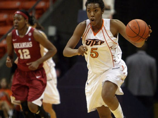 UTEP's Kayla Thornton drives the ball down court on a fast break against Arkansas in a game at the Don Haskins Center.