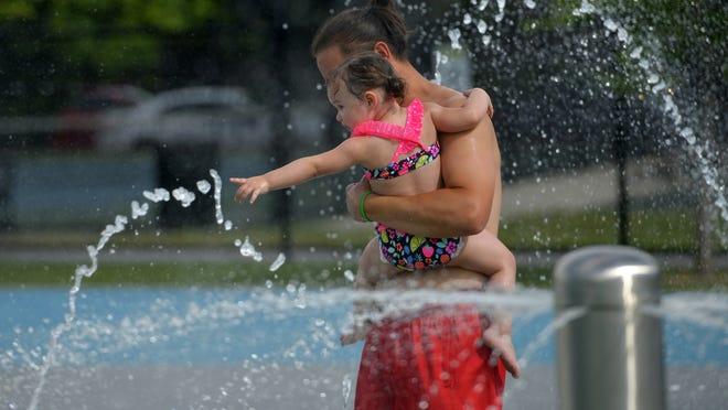 Anthony and Violet Vuona take in the East Park Spray Park on Wednesday.