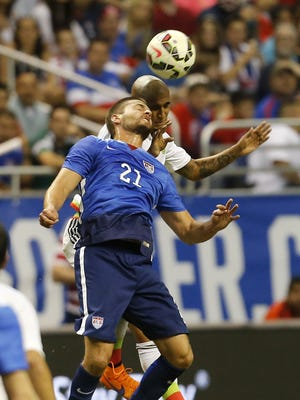 SAN ANTONIO, TX - APRIL 15:  Perry Kitchen #21 of the United States jumps for a header against Luis Rodriguez #8 of Mexico during an international friendly match at the Alamodome on April 15, 2015 in San Antonio, Texas.