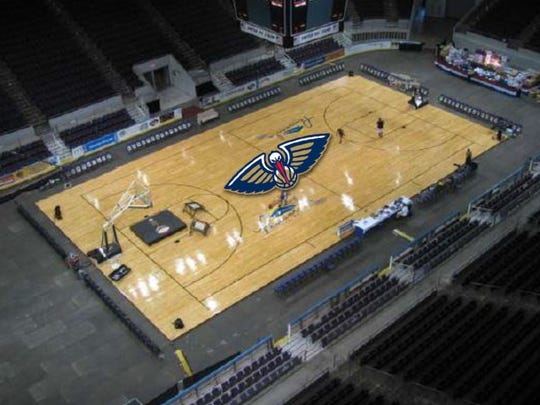 A concept image shows the New Orleans Pelicans logo on the court at the Pensacola Bay Center.
