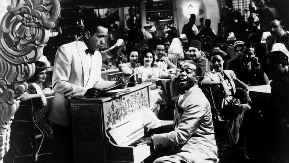 "Nightclub owner Rick (Humphrey Bogart, left) listens to piano player Sam (Dooley Wilson) in ""Casablanca."""