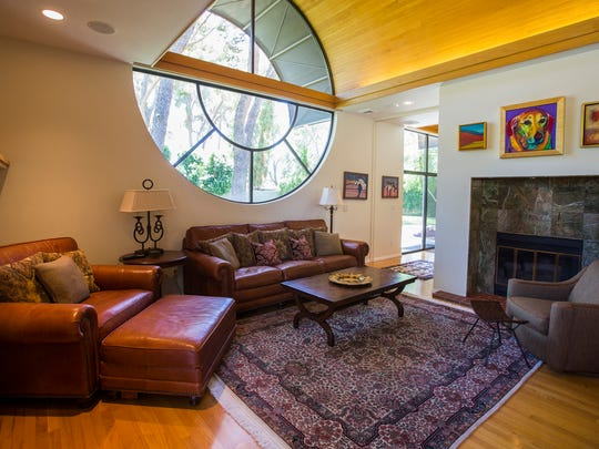 Family room in Virginia and John Walsh's home in Phoenix. The home was built in 1981 late architect Paolo Soleri.