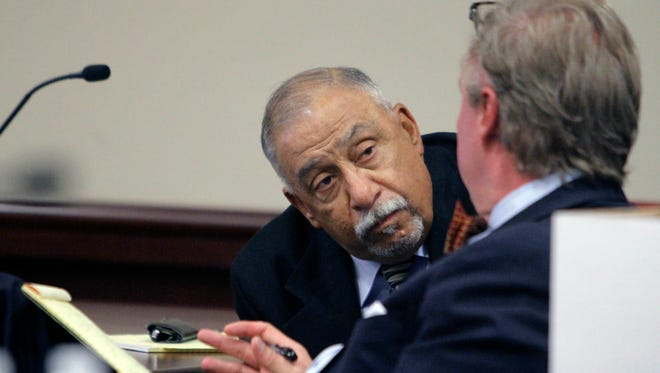 Former state Sen. Phil Griego, left, speaks to his attorney, Tom Clark, during his preliminary hearing at district court on Thursday, July 7, 2016 in Albuquerque, N.M. Witnesses called to testify Tuesday in a fraud case against former state Sen. Phil Griego told prosecutors they were left guessing about the lawmaker's involvement in the sale of a state-owned building in downtown Santa Fe that would later earn Griego a $51,000 commission.