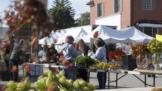 Shoppers look at dried flowers at the End of Season celebration Sunday at Birmingham Farmers Market in Birmingham.