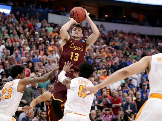 Loyola-Chicago guard Clayton Custer (13) shoots over
