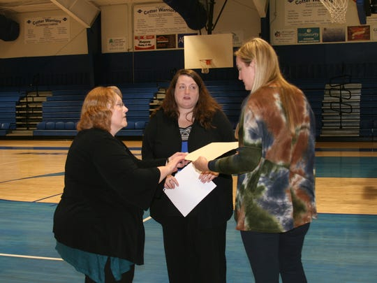 """Cotter City Recorder/treasurer and high school business teacher Andrea Kray (center) presents a proclamation to high school counselor Heather Thornton (right) marking Tuesday, March 27 as """"Kick Butts Day 2018."""" Also pictured is Tawana Manning with the Arkansas Department of Health's Tobacco Prevention & Cessation Program (left)."""