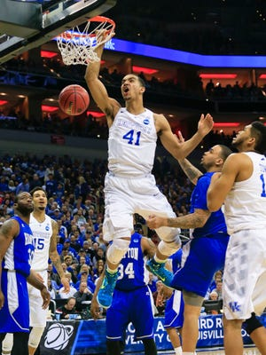 Kentucky's Trey Lyles slams down two points early against Hampton in the first half of the late game at the NCAA Louisville Regional. By Matt Stone, The Courier-Journal March 19, 2015