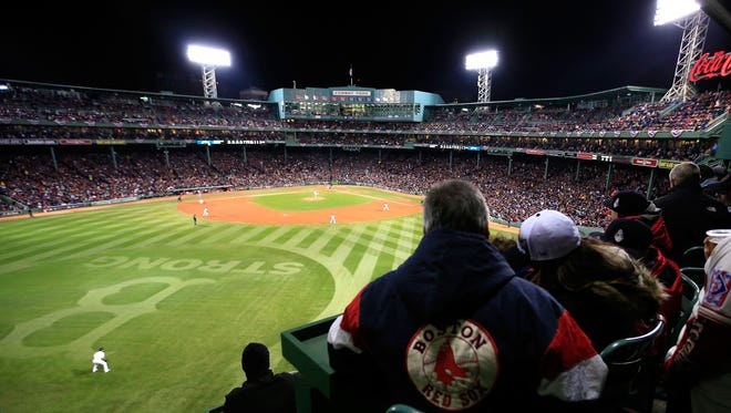 Fans watch Game 2 of the 2013 World Series between the Boston Red Sox and the St. Louis Cardinals at Fenway Park.