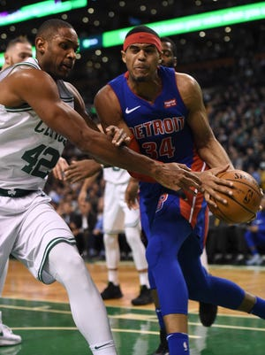 Pistons forward Tobias Harris (34) drives to the basket past Celtics forward Al Horford (42) during the first half on Monday, Nov. 27, 2017, in Boston.