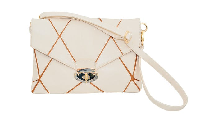 Cream geometric lined bag, $50, at Indigeaux.