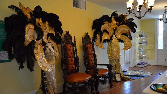 The Mardi Gras Museum has a spectacular display of costumes and a fun gift shop filled with all items purple, green and gold.