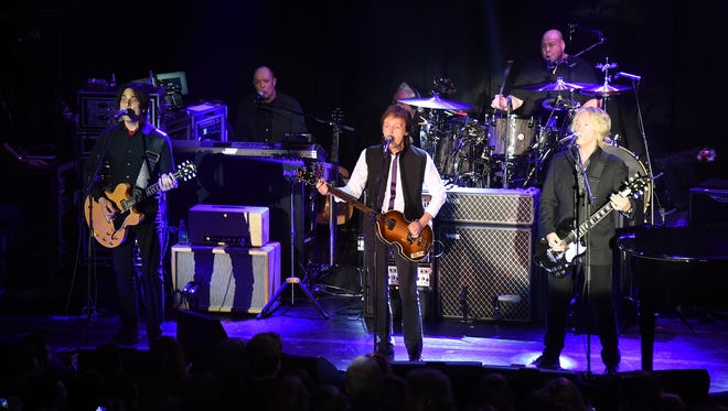 Paul McCartney and his band perform at Irving Plaza in New York City on Feb. 14, 2015.