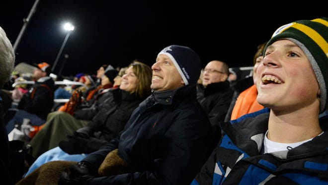 Carter Bowman, right, watches football with his family at Central York High School in 2013.