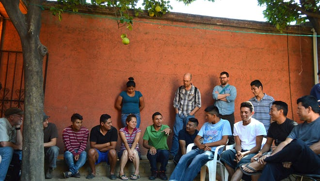 Immigrants from Central America gathered in a courtyard in southern Mexico to share their experiences with visiting Midwesterners.