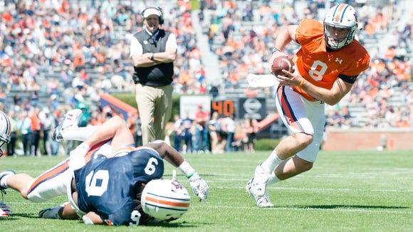 Auburn quarterback Jarrett Stidham (8) recovers a fumble  and runs for a touchdown during Auburn's A-Day on Saturday, April 8, 2017, at Jordan Hare Stadium in Auburn, Ala.