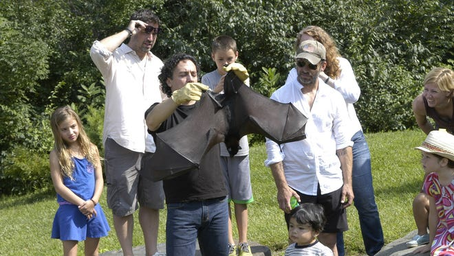 """""""Batman v. Superman: Dawn of Justice"""" director Zack Snyder (in baseball cap) and some members of the film's crew visited the Bat Zone at the Crabrook Institute of Science in Bloomfield Hills."""