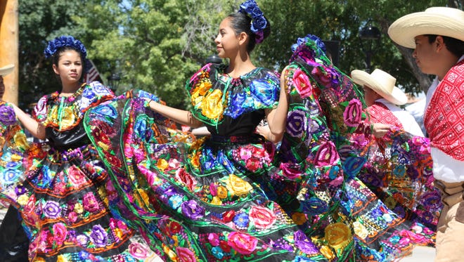 Dancers dance a traditional Mexican dance during the Diez y seis de Septiembre festivities at Mesilla Plaza Saturday.