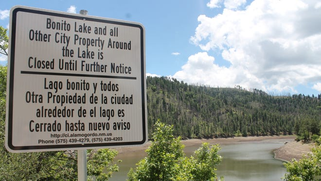 In this file photo, a sign warns visitors that Bonito Lake is closed for the time being. The City of Alamogordo continues restoration work on the lake following damage from the 2012 Little Bear Fire and subsequent flooding in the area.