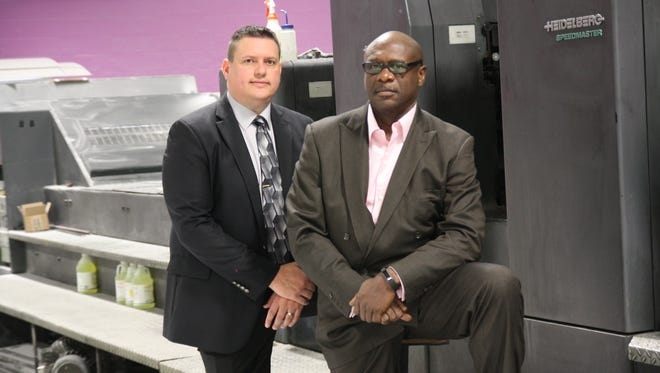 Panther Graphics' Vice President Josh Cummings, left, and President and founder Tony Jackson.