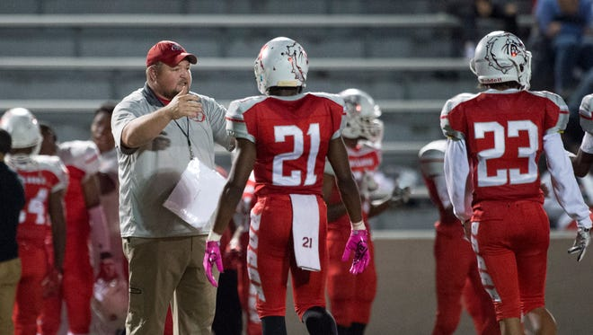 Bosse Head Coach Eric Schnur talks to Bosse's Sheldon Clay (21) as they face Boonville High School at Enlow Field in Evansville, Ind., on Friday, Oct. 20, 2017. Bosse won 20-14.