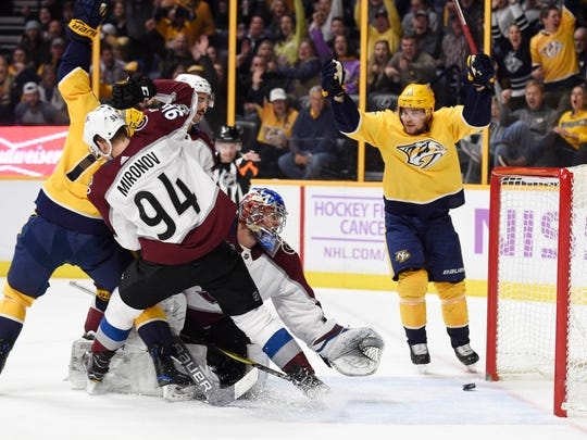 Nov 18, 2017; Nashville, TN, USA; Nashville Predators left wing Austin Watson (51) and  right wing Craig Smith (15) celebrate a goal in front of Colorado Avalanche defenseman Andrei Mironov (94) and goalie Semyon Varlamov (1) during the first at period Bridgestone Arena.
