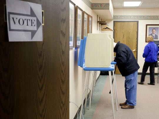 A man casts a ballot at Bethany Reformed Church polls