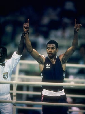 Roy Jones Jr. of the United States celebrates after a bout in the 1988 Summer Olympic Games in Seoul, South Korea. Jones went on to lose in the gold medal bout in a decision that was highly controversial.
