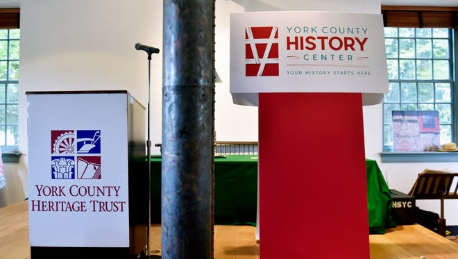 The old York County Heritage Trust logo and the new York County History Center logo are displayed during an unveiling event at the Colonial Courthouse in York Thursday, June 16, 2016. The York County Heritage Trust formally announced the nonprofit is now rebranded as the York County History Center, coinciding with its upcoming move to the former Met-Ed steam plant.