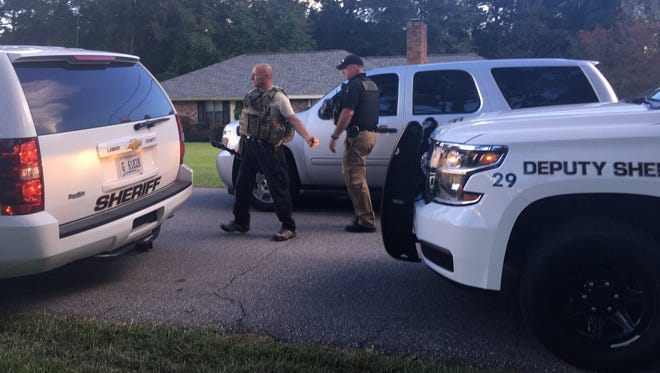 A woman barricaded herself in a home after the U.S. Marshals Service tried to serve her a warrant.