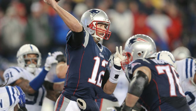 New England Patriots quarterback Tom Brady (12) fires a pass inside the Colts defense in the first half. The Colts traveled to Gillette Stadium for the AFC Championship game with the New England Patriots Sunday, January 18, 2015.