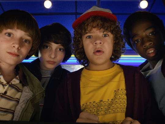 """Noah Schnapp, from left, Finn Wolfhard, Gaten Matarazzo and Caleb McLaughlin in a scene from """"Stranger Things."""" The second season will premiere Friday on Netflix."""