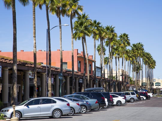 Palm-lined sidewalks connect popular shops, restaurants