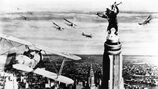 In 1933's 'King Kong,' the colossal creature climbs atop New York's Empire State Building, snatching a fighter plane as he's attacked.