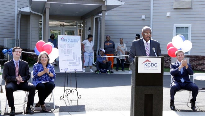 Knoxville District 6 Councilman Daniel Brown speaks as (from left) KCDC Executive Director Ben Bentley, Knoxville Mayor Madeline Rogero and Knox County Mayor Tim Burchett applaud at the opening of the Residences at Five Points.