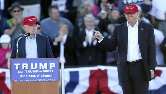 Republican presidential candidate Donald Trump, right, gestures as Sen. Jeff Sessions, R-Ala., speaks during a rally Sunday, Feb. 28, 2016, in Madison, Ala.