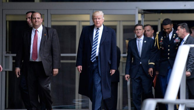 Wisconsin political insider John Hiller (left) exits the CIA headquarters with President Donald Trump.